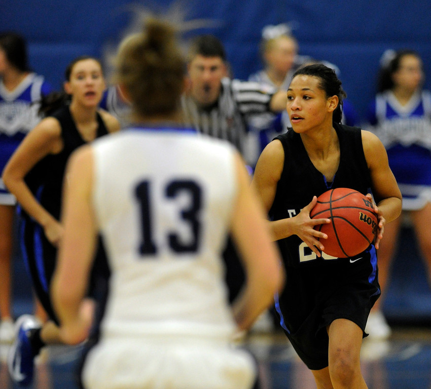 . PARKER, CO. - FEBRUARY 15: Falcons point guard Ciera Morgan (20) worked the ball ahead in the second half. The Highlands Ranch High School girls\'s basketball team defeated Legend 76-31 Friday night, February 15, 2013. Falcon\'s coach Caryn Jarocki earned her 500th career win. (Photo By Karl Gehring/The Denver Post)
