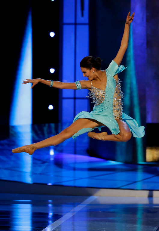 . Miss Alabama Caitlin Brunell dances during the talent portion of the Miss America 2015 pageant, Sunday, Sept. 14, 2014, in Atlantic City, N.J. (AP Photo/Mel Evans)