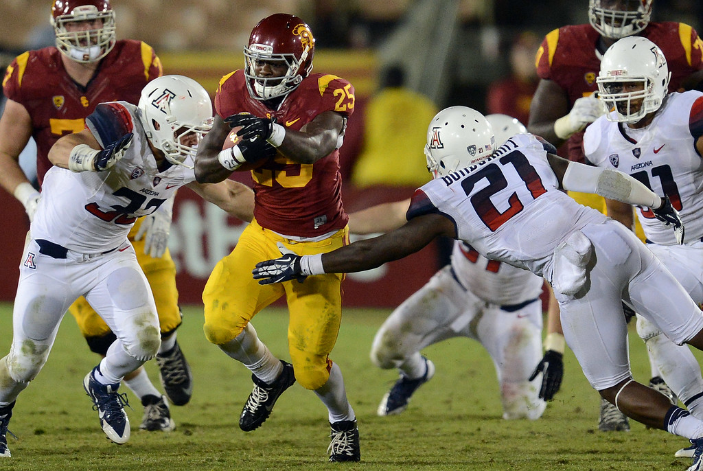 . USC\'s  Silas Redd #25 heads up field during their game against Arizona at the Los Angeles Memorial Coliseum Thursday, October 10, 2013. USC defeated Arizona 38-31. (Photo by Hans Gutknecht/Los Angeles Daily News)
