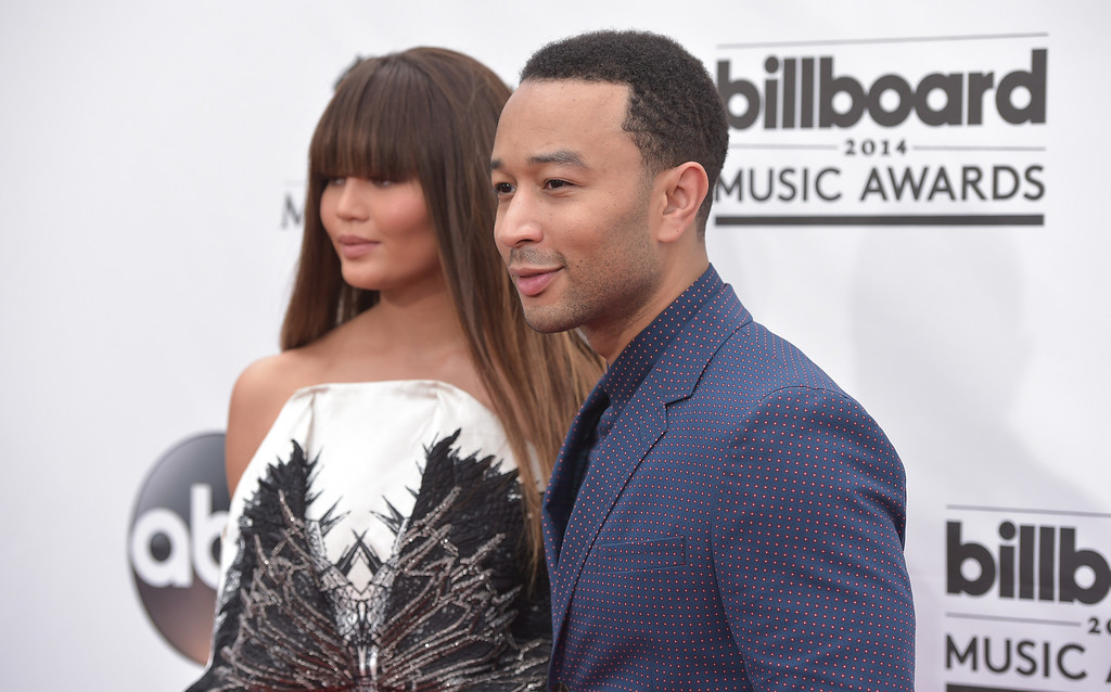 . Chrissy Teigen, left, and John Legend arrive at the Billboard Music Awards at the MGM Grand Garden Arena on Sunday, May 18, 2014, in Las Vegas. (Photo by John Shearer/Invision/AP)