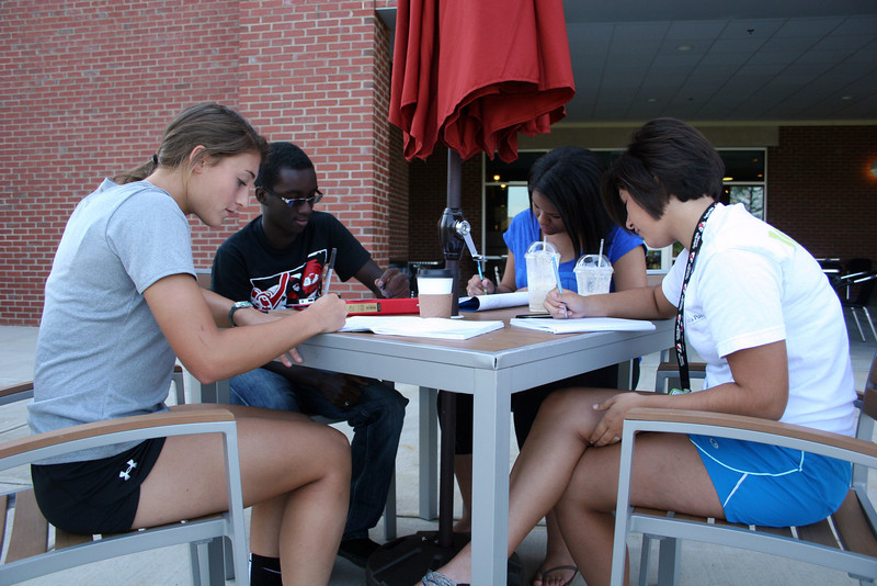 Group of Gardner-Webb University students studying at the Tucker Student Center.