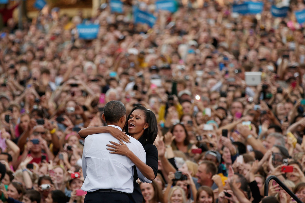 . U.S. President Barack Obama and first lady Michelle Obama embrace during a campaign rally at the University of Iowa September 7, 2012 in Iowa City, Iowa. This is Obama and Biden\'s first day of campaigning after accepting the nomination for president yesterday at the Democratic National Convention in Charlotte, North Carolina.  (Photo by Chip Somodevilla/Getty Images)