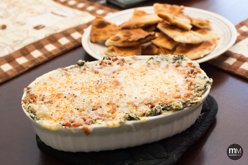Joy's *amazing* spinach dip, topped with diced bacon and a layer of Italian cheese.