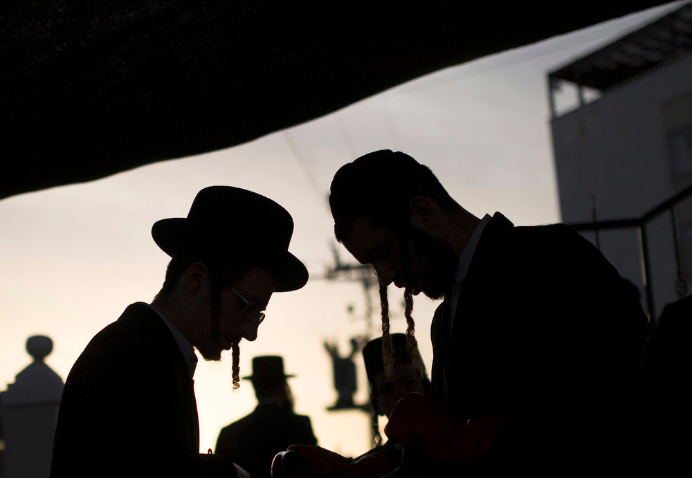 . Ultra-Orthodox Jewish men prepare to dip cooking utensils in boiling water to remove remains of leaven ahead of the upcoming Jewish holiday of Passover in the southern city of Ashdod March 20, 2013. Passover, which starts next week, commemorates the flight of Jews from ancient Egypt, as described in the Exodus chapter of the Bible. According to the account, the Jews did not have time to prepare leavened bread before fleeing to the promised land. REUTERS/Amir Cohen