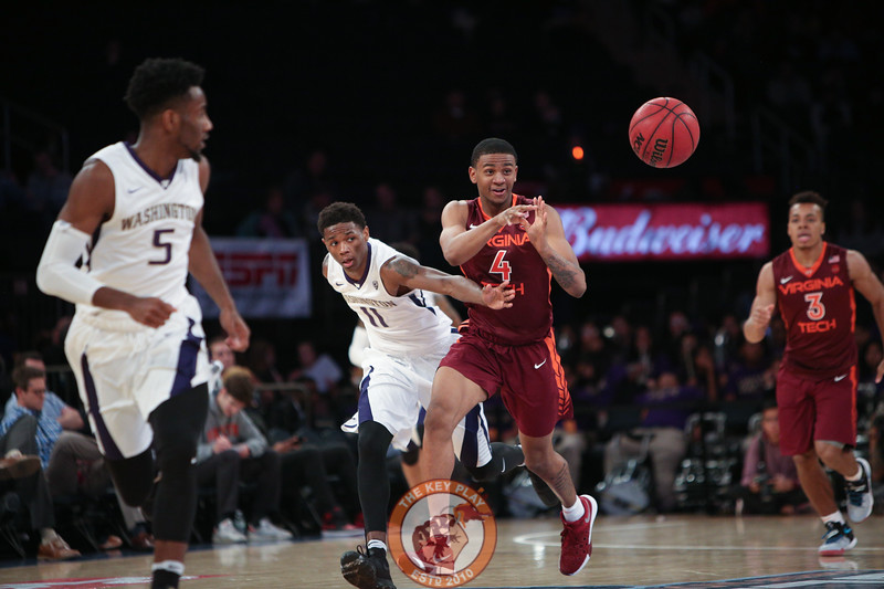 Virginia Tech's guard Nickeil Alexander-Walker (4) passes the ball as Washington's forward Nahziah Carter (11) defends in Madison Square Garden, Nov. 17, 2017. Virginia Tech won the game 103-79.