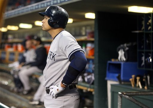 . New York Yankees designated hitter Alex Rodriguez is seen in the dugout during the sixth inning of a baseball game against the Detroit Tigers, Tuesday, April 21, 2015, in Detroit. (AP Photo/Carlos Osorio)
