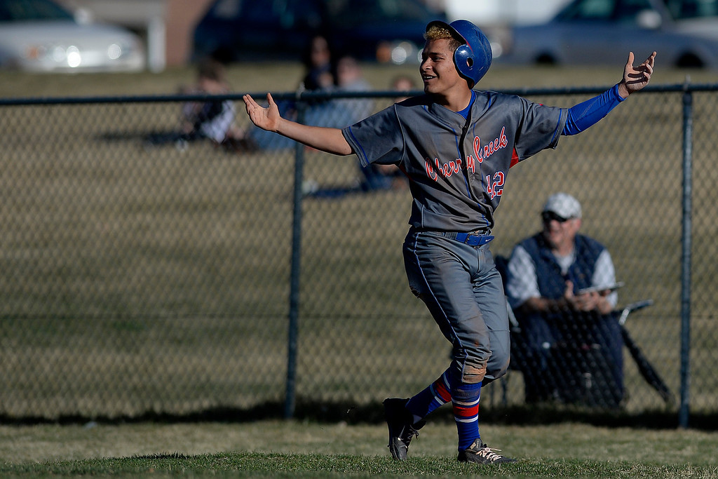. Aurora, CO - APRIL 08: Aeneas Roberson (42) of the Cherry Creek Bruins reacts to getting picked off at first base by Dario Villagomez (2) of the Overland Trailblazers for the second out of the sixth inning. Overland hosted Cherry Creek on Tuesday, April 8, 2014. (Photo by AAron Ontiveroz/The Denver Post)