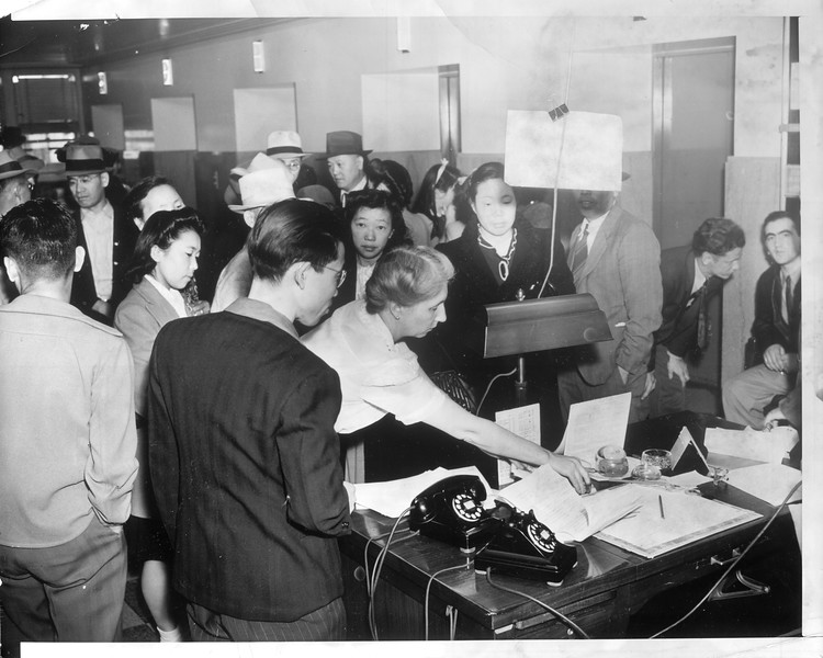 """""""Jap aliens getting traveling permits -- aliens at U.S. Attorneys office""""--caption on photograph"""