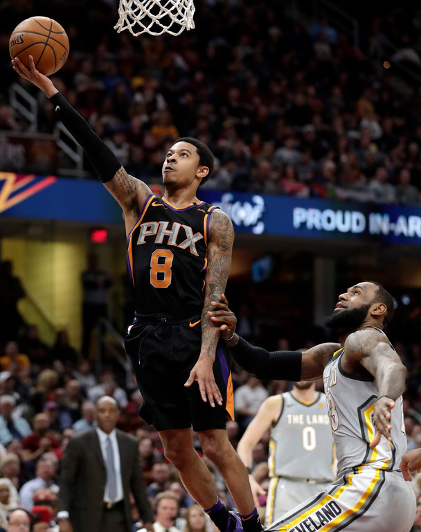 . Phoenix Suns\' Tyler Ulis (8) drives to the basket against Cleveland Cavaliers\' LeBron James (23) during the first half of an NBA basketball game Friday, March 23, 2018, in Cleveland. (AP Photo/Tony Dejak)