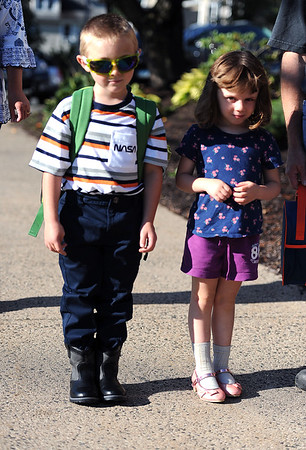 8/29/2019 Mike Orazzi | Staff Gabriel and Scarlett Cormier arrive at the Derynoski Elementary School on Southington's first day back this year.