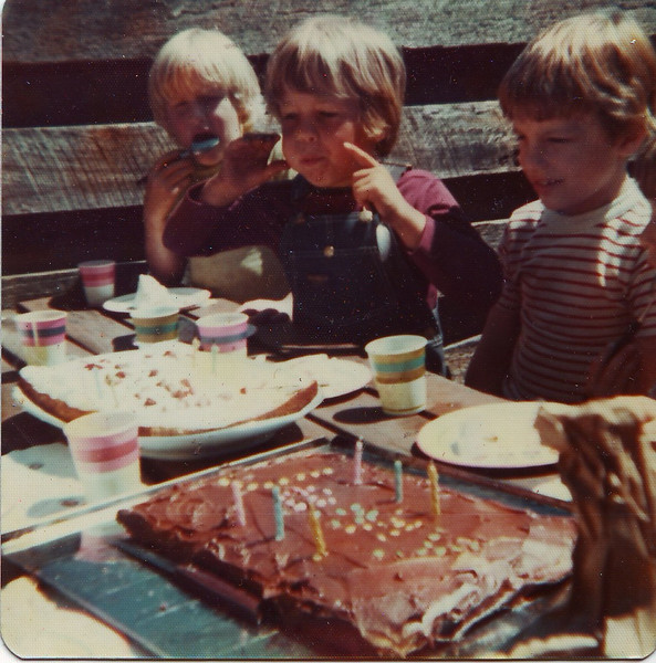 This is the same birthday party as the other picture. It looks like it is #6 though?? There is my twin brother Joel blowing out his candles. My mom made us two cakes! The blond little boy with the spoon is Bob Sagerson.  I didn't think we lived on Capitol Hill in Seattle (where I think this picture is taken) at 6 years old though.
