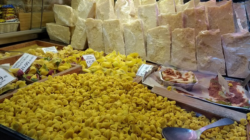 homemade pasta and cheese for sale at the Bologna food market.