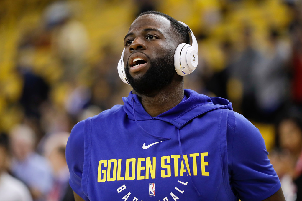 . Golden State Warriors forward Draymond Green warms up before Game 1 of basketball\'s NBA Finals between the Warriors and the Cleveland Cavaliers in Oakland, Calif., Thursday, May 31, 2018. (AP Photo/Marcio Jose Sanchez)