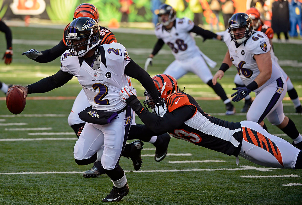 Description of . Baltimore Ravens quarterback Tyrod Taylor (2) is sacked by Cincinnati Bengals defensive end Michael Johnson (93) in the first half of an NFL football game on Sunday, Dec. 30, 2012, in Cincinnati. (AP Photo/Michael Keating)