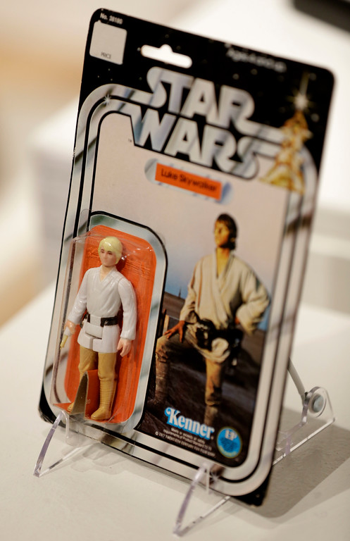 . A rare Luke Skywalker toy from the \'Star Wars\' movie series is displayed during a press preview at Sotheby\'s in New York, Wednesday, Dec. 2, 2015. Sotheby\'s is holding an online auction of hundreds of rare and original objects associated with the space odyssey series. (AP Photo/Seth Wenig)