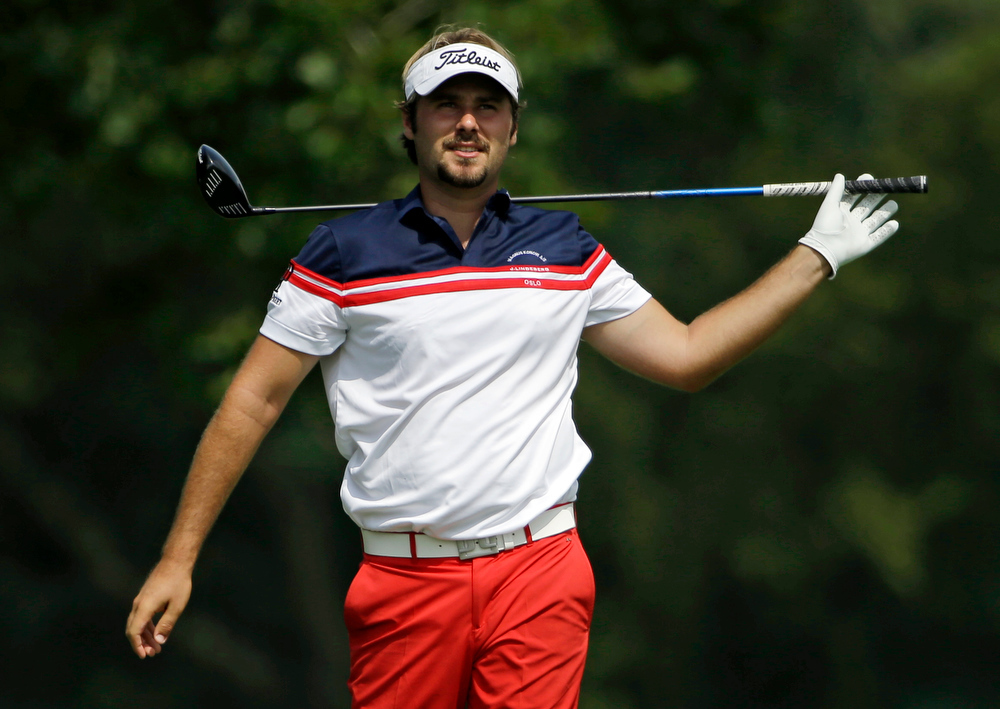 . Victor Dubuisson, of France, watches his tee on the fifth hole during the final round of the PGA Championship golf tournament at Valhalla Golf Club on Sunday, Aug. 10, 2014, in Louisville, Ky. (AP Photo/David J. Phillip)