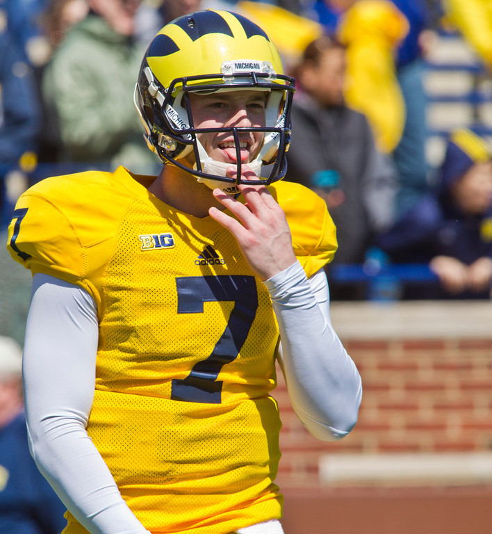 . Michigan quarterback Shane Morris (7) smiles, wearing his helmet, during the football team\'s annual spring game, Saturday, April 5, 2014, in Ann Arbor, Mich. (AP Photo/Tony Ding)
