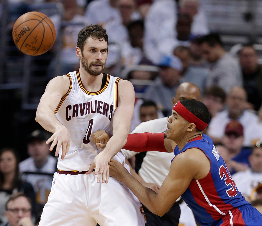 . Cleveland Cavaliers\' Kevin Love (0) passes against Detroit Pistons\' Tobias Harris (34) in the second half in Game 1 of a first-round NBA basketball playoff series, Sunday, April 17, 2016, in Cleveland. (AP Photo/Tony Dejak)