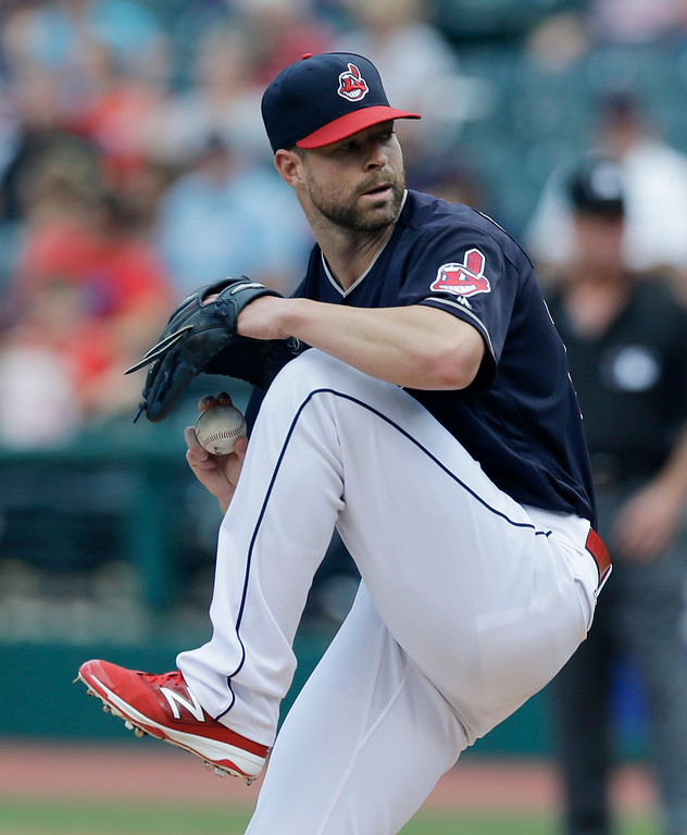 . Cleveland Indians starting pitcher Corey Kluber delivers in the first inning of a baseball game against the Kansas City Royals, Sunday, June 5, 2016, in Cleveland. (AP Photo/Tony Dejak)