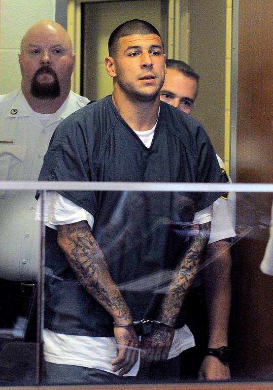 . Former New England Patriots football player Aaron Hernandez enters a courtroom for a bail hearing in Fall River Superior Court Thursday, June 27, 2013 in Fall River, Mass. Hernandez, charged with murdering Odin Lloyd, a 27-year-old semi-pro football player, was denied bail. (AP Photo/Boston Herald, Ted Fitzgerald, Pool)