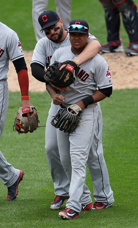. Cleveland Indians relief pitcher Cody Allen, left, celebrates with Jose Ramirez after the team\'s 5-2 win over the Chicago White Sox in a baseball game Thursday, June 14, 2018, in Chicago . (AP Photo/Annie Rice)