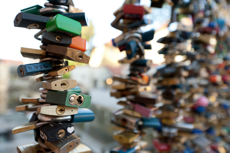 Close-up shot of locks at a bar in Charles Bridge - Prague, Czech Republic