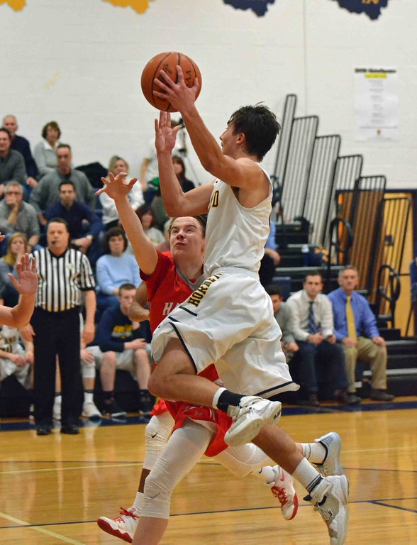 . Paul DiCicco - The News-Herald Kirtland�s Jeremy Davis jumps to pass the ball across the court in the fourth quarter.