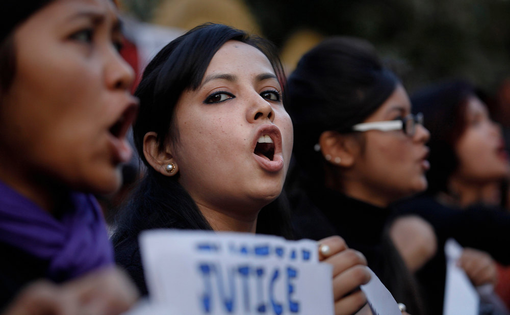 Description of . Students shout slogans during a protest against a leader of the ruling Congress party, who was arrested on accusations he raped a woman in a village in the early hours of the morning, in Gauhati, India, Thursday, Jan. 3, 2013. Footage on Indian television showed the extraordinary scene of local women surrounding Bikram Singh Brahma, ripping off his shirt and repeatedly slapping him across the face. A Dec. 16 gang rape on a woman, who later died of her injuries, has caused outrage across India, sparking protests and demands for tough new rape laws, better police protection for women and a sustained campaign to change society's views about women. (AP Photo/Anupam Nath)