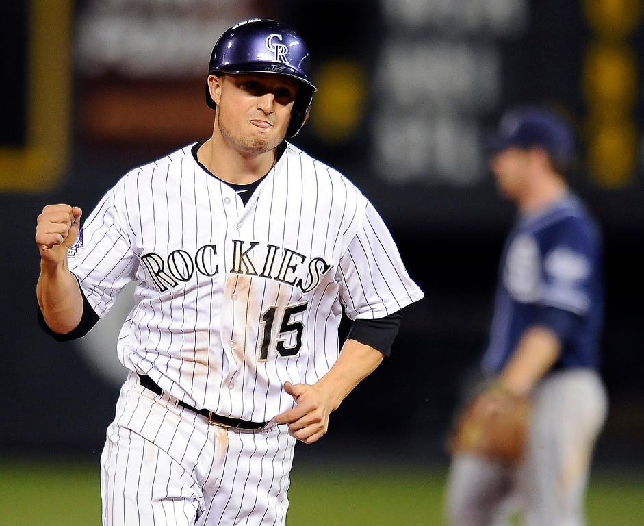 . Colorado Rockies\' Jordan Pacheco celebrates a two-run home run by Wilin Rosario in the eigth inning of a baseball game against the San Diego Padres on Thursday, June 6, 2013 in Denver. (AP Photo/Chris Schneider)