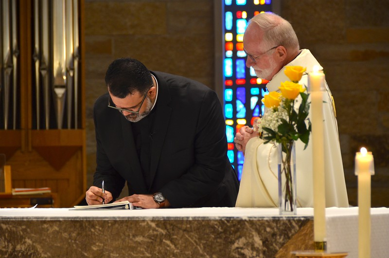 Signing his perpetual profession