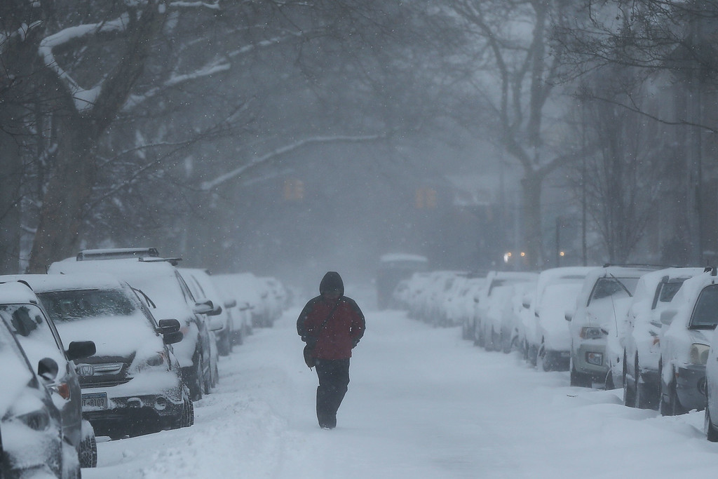 . A Brooklyn street is viewed the morning after a major winter storm on January 27, 2015 in New York City. Despite dire predictions, New York City was spared the worst of the storm, receiving up to a foot of snow in some areas. Subway buses were closed overnight while roadways were open only to emergency vehicles.  (Photo by Spencer Platt/Getty Images)