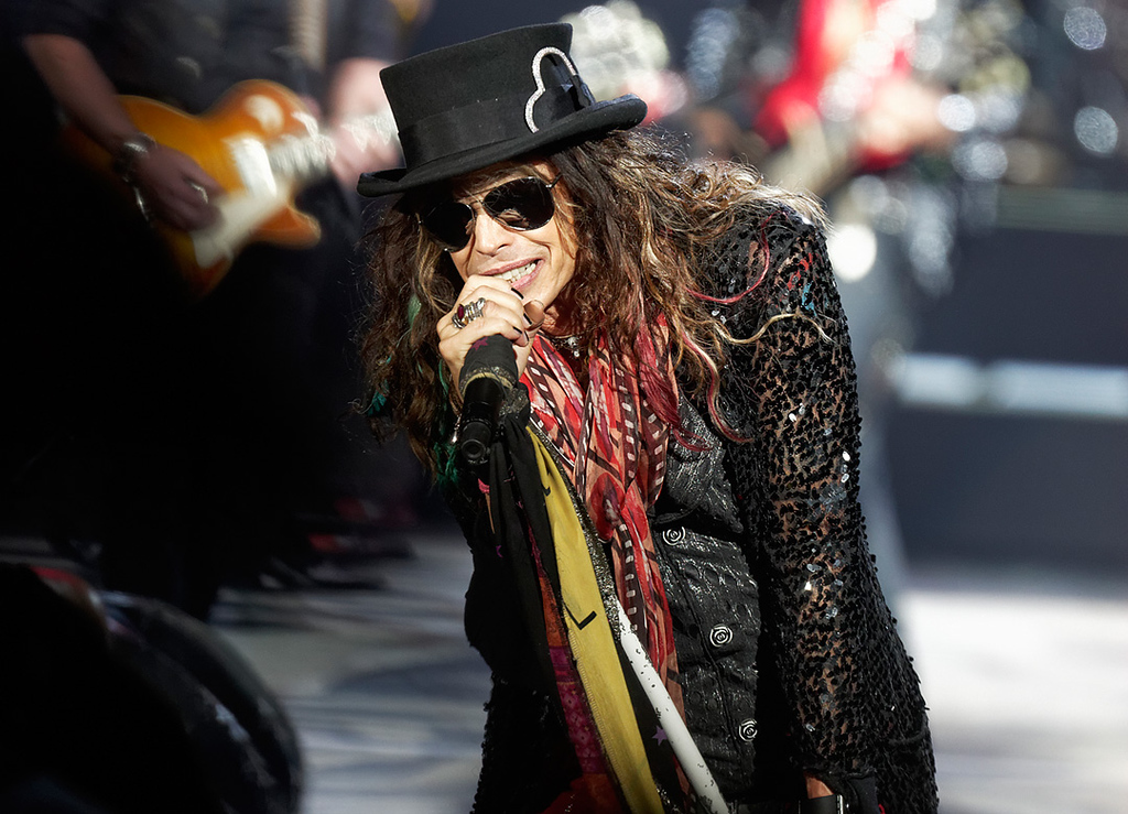 . Steven Tyler of Aerosmith performs on Tuesday, Sept. 9, 2014, at DTE Energy Music Theatre in Independence Township. Photo by Ken Settle