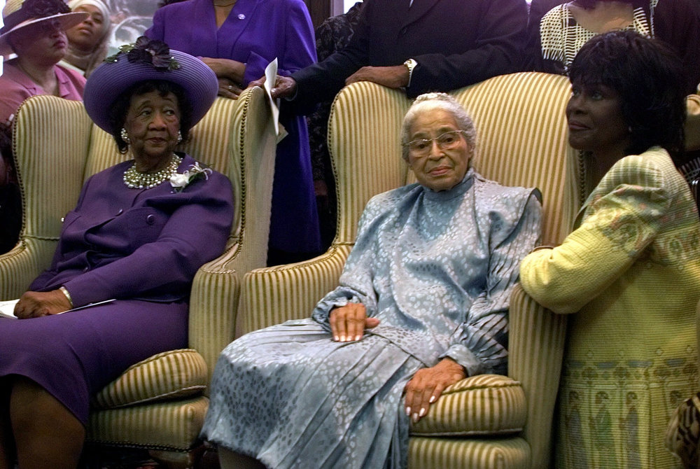 Description of . Rosa Parks, joined by Dorothy Height, president emeritus and chairman of the board of the National Council of Negro Women, left, and actress Cicely Tyson, right, take part in