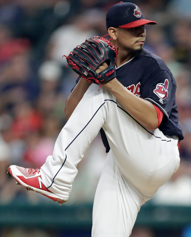 . Cleveland Indians starting pitcher Carlos Carrasco winds up during the first inning of the team\'s baseball game against the Minnesota Twins, Tuesday, Aug. 7, 2018, in Cleveland. (AP Photo/Tony Dejak)