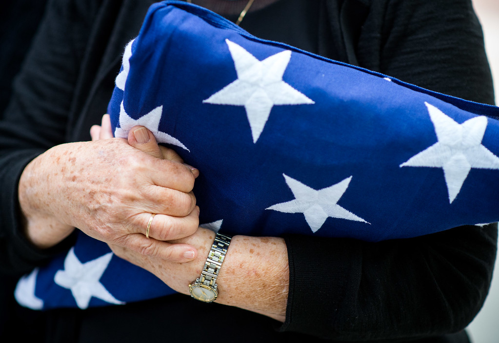 . Brittarose Morgan, 77, wife of the late Airman First Class Roland Morgan, cradles the U.S. flag given by the Blue Eagles Honor Guard at Riverside National Cemetery in Riverside, Calif. on Tuesday, May 19, 2015. (Photo by Watchara Phomicinda/ Los Angeles Daily News)