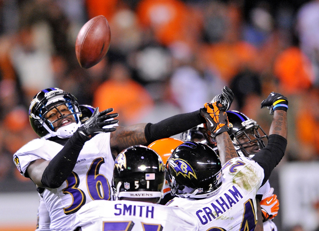 . Baltimore Ravens strong safety Jeromy Miles (36) breaks up a last-second pass by the Cleveland Browns at the end of the first half of an NFL football game Sunday, Nov. 3, 2013. (AP Photo/David Richard)