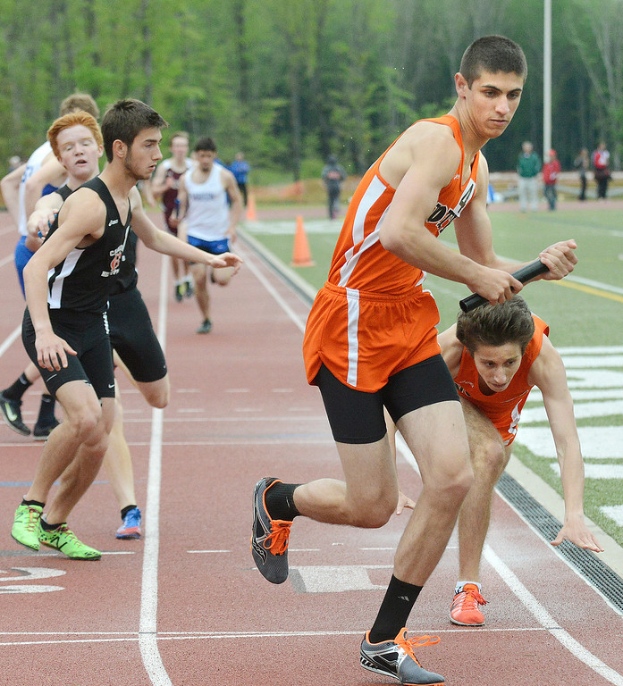 . Maribeth Joeright/MJoeright@News-Herald.com<p> North\'s Dan Car collapses after handing the baton to his teammate and anchor Jack Petrecca in the boys 4X800 meter relay during the PAC meet at SPIRE Institute, May 15, 2014. North edged out Chardon to win the event.