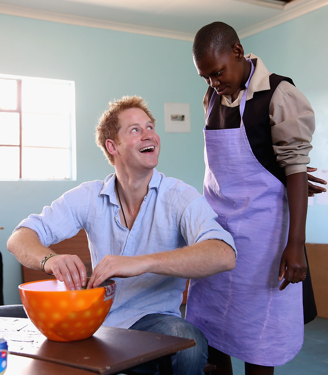 . Prince Harry makes papier mache bowls during a visit to the Thuso Centre for children living with multiple disabilities on December 7, 2014 in Bute-Bute, Lesotho.  (Photo by Chris Jackson/Getty Images for Sentebale)