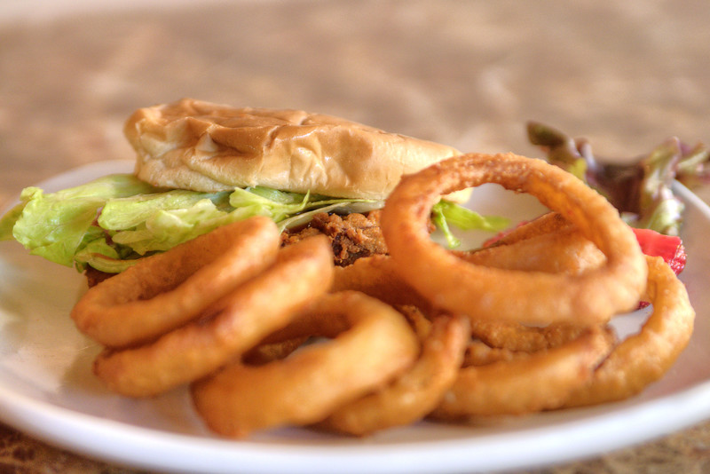 A veal burger with onion rings at Scoots Restaurant on Main Street in Galax, VA on Thursday, May 30, 2013. Copyright 2013 Jason Barnette