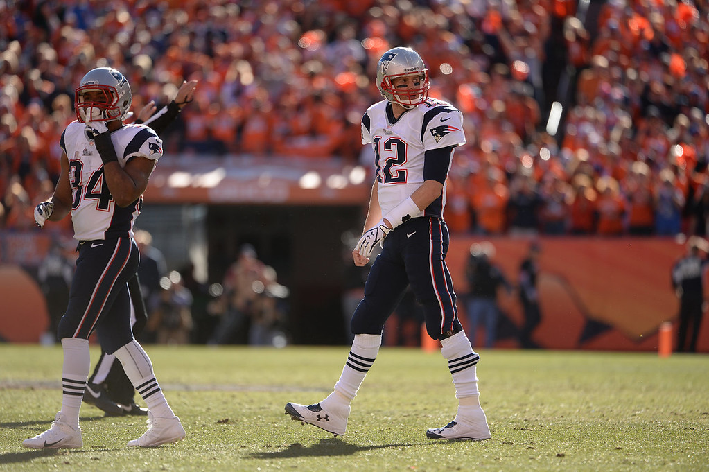 . New England Patriots quarterback Tom Brady (12) in the second quarter. The Denver Broncos take on the New England Patriots in the AFC Championship game at Sports Authority Field at Mile High in Denver on January 19, 2014. (Photo by Hyoung Chang/The Denver Post)