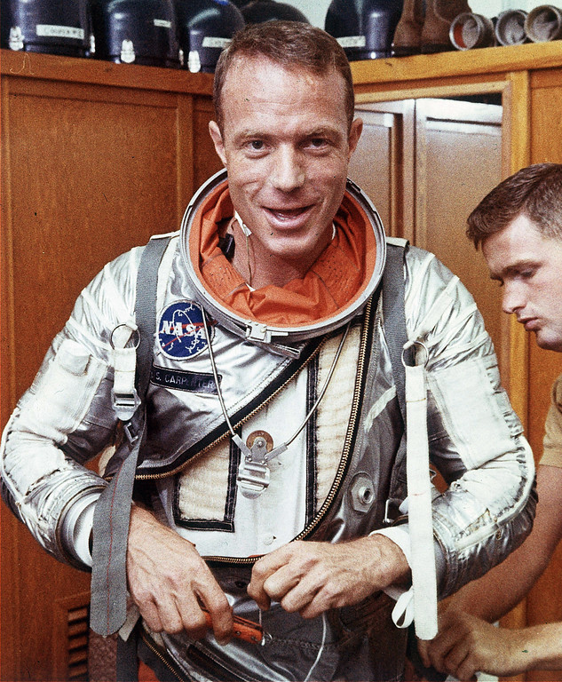 . FILE - In this Aug. 1962 file photo, astronaut Scott Carpenter has his space suit adjusted by a technician in Cape Canaveral, Fla. Carpenter, the second American to orbit the Earth and one of the last surviving original Mercury 7 astronauts, died Thursday, Oct. 10, 2013. He was 88. (AP Photo, File)