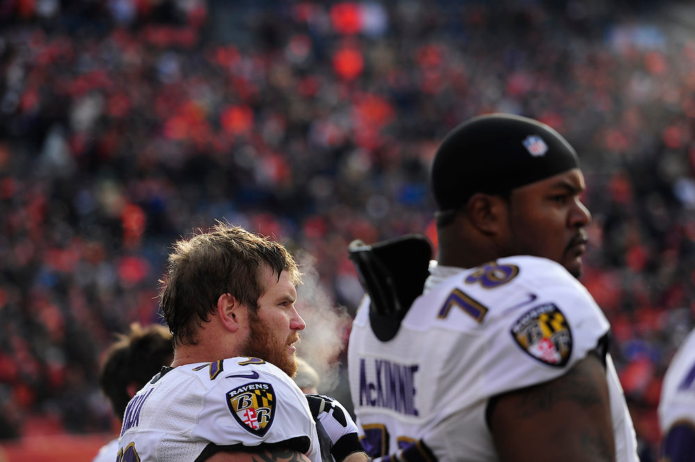 Description of . Baltimore Ravens guard Marshal Yanda (73) and Baltimore Ravens tackle Bryant McKinnie (78) watch from the sidelines before the game. The Denver Broncos vs Baltimore Ravens AFC Divisional playoff game at Sports Authority Field Saturday January 12, 2013. (Photo by AAron  Ontiveroz,/The Denver Post)