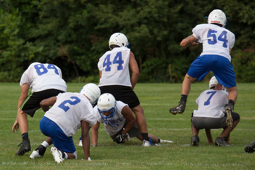 . Jen Forbus - The Morning Journal<br> The senior squad members practice some strength-building leap-frog drills during Clearview\'s first football practice on July 30.