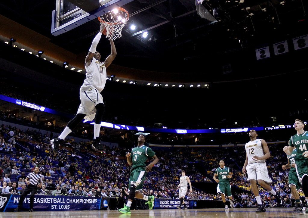 . Cleanthony Early #11 of the Wichita State Shockers dunks against the Cal Poly Mustangs during the second round of the 2014 NCAA Men\'s Basketball Tournament at the Scottrade Center on March 21, 2014 in St Louis, Missouri.  (Photo by Andy Lyons/Getty Images)