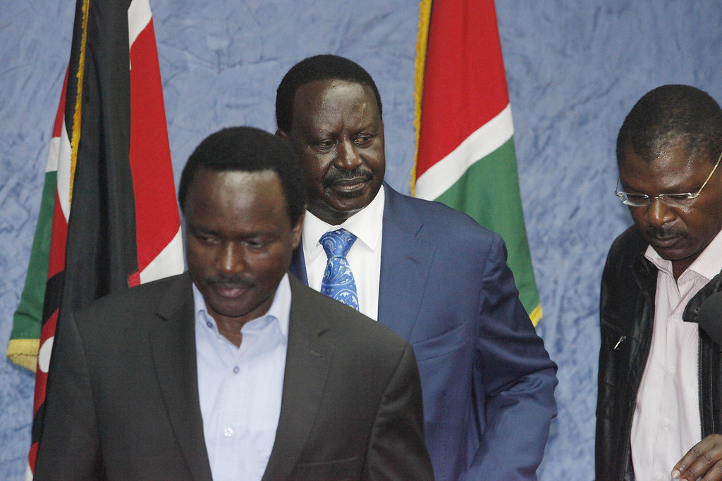 . Outgoing Kenyan Prime Minister Raila Odinga (C), with Kalonzo Musyoka (L) Kenya\'s outgoing vice president and Odinga\'s running mate, leaves a press conference at his office in Nairobi after addressing the media on March 30, 2013. The Kenyan Supreme Court ruled on March 30 on a petition by outgoing Kenyan Prime Minister Raila Odinga challenging the election of contender Uhuru Kenyatta during the March 4 elections. The Supreme Court upheld the victory of Uhuru Kenyatta in the March 4 election, said Chief Justice Willy Mutunga. Odinga conceded defeat and wished Uhuru Kenyatta well in running the affairs of government. Till Muellenmeister/AFP/Getty Images