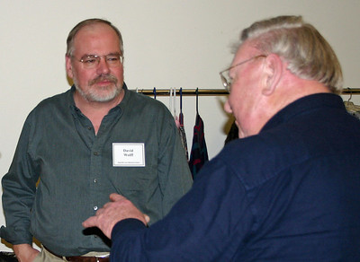 "Professor David Wolff (left) visiting with some of the audience following his March 2008 presentation on Seth Bullock.  Wolff believes the popular HBO television series  Deadwood created a broader public awareness of Deadwood than it had previously enjoyed.   ""While much of the story line was historical fiction, I think the town was portrayed fairly...the show did use a lot of foul language, and I don't believe that the people talked that way."""
