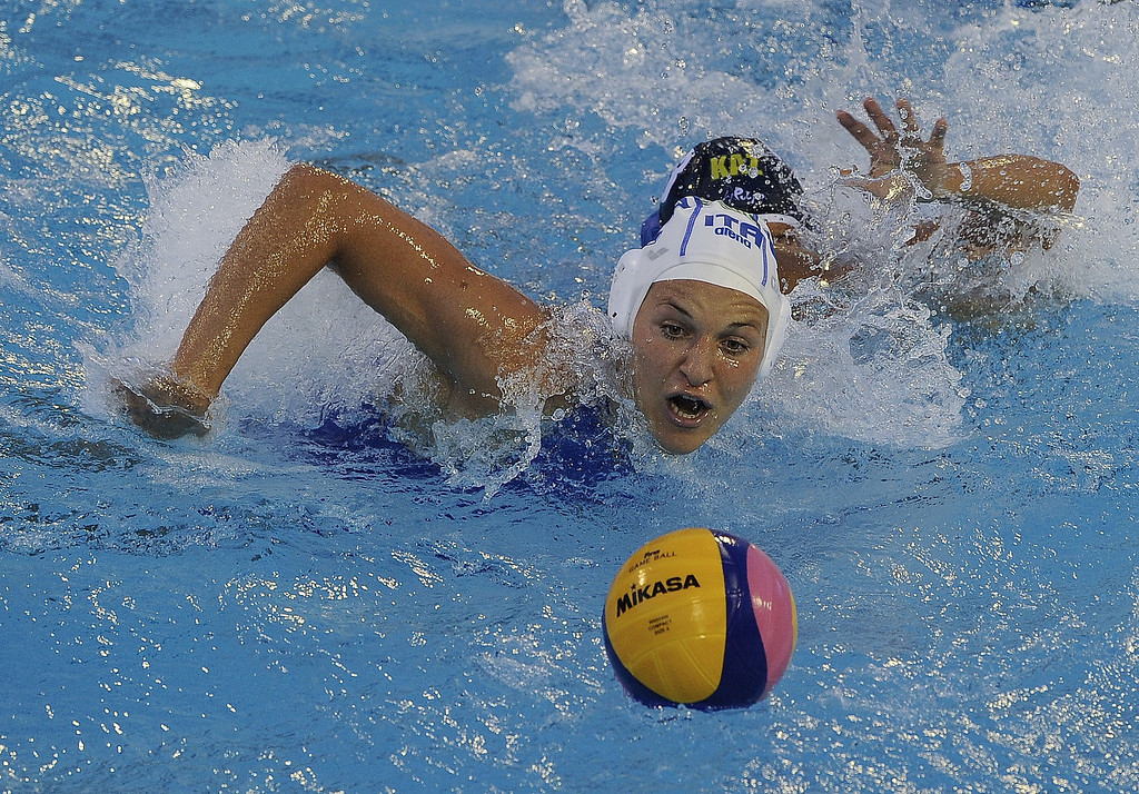 . Italy\'s Teresa Frassinetti chases down the ball as Kazakhstan\'s Aizhan Akilbayeva (back) follows up during their preliminary round match of the women\'s water polo competition at the FINA World Championships in Bernat Picornell pools in Barcelona on July 21, 2013. Italy won the match 9-7.    JOSEP LAGO/AFP/Getty Images
