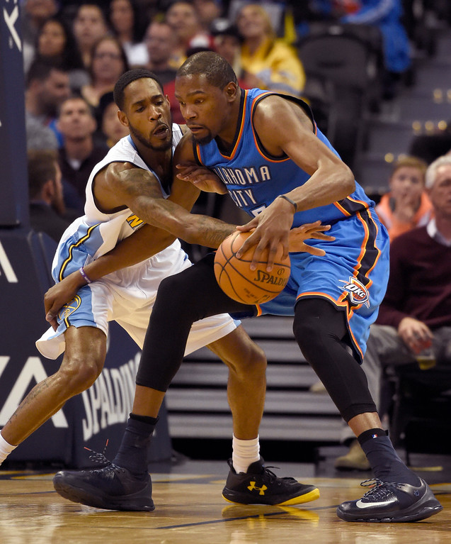 . Denver Nuggets forward Will Barton (5) reaches in a swats the ball away from Oklahoma City Thunder forward Kevin Durant (35) during the second quarter April 5, 2016 at Pepsi Center. (Photo By John Leyba/The Denver Post)