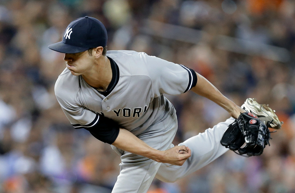 . New York Yankees pitcher Shane Greene throws against the Detroit Tigers in the fourth inning of a baseball game in Detroit, Wednesday, Aug. 27, 2014. (AP Photo/Paul Sancya)