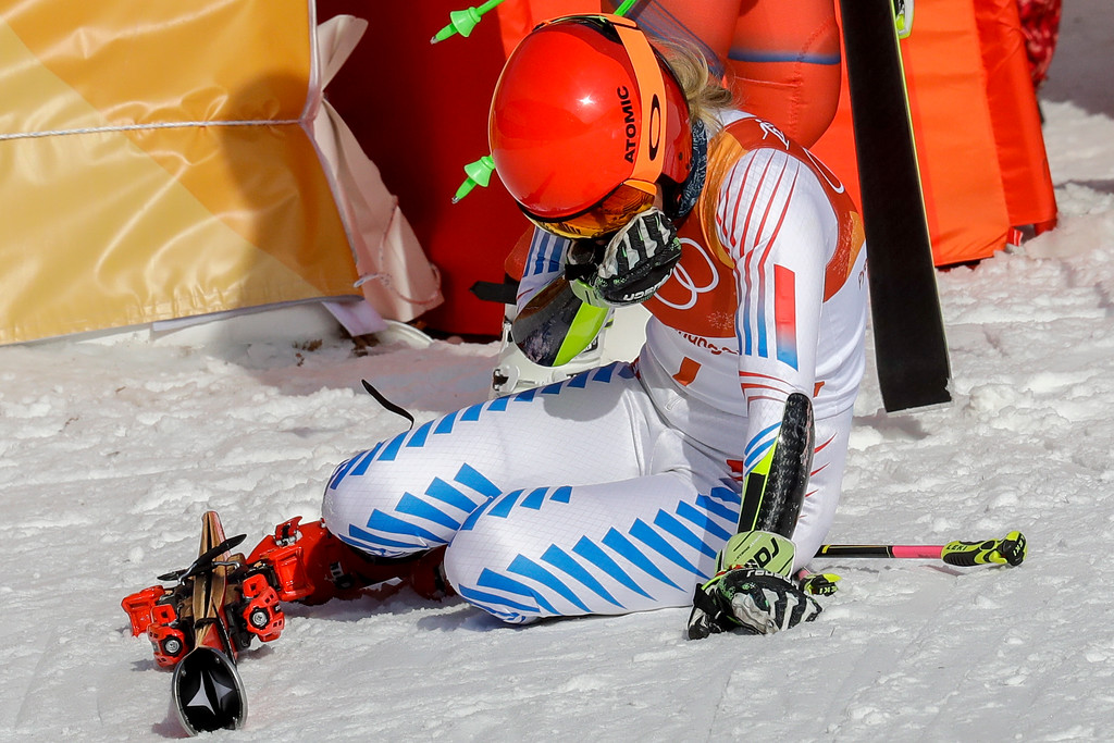 . Mikaela Shiffrin, of the United States, falls to her knees after winning the gold medal in the Women\'s Giant Slalom at the 2018 Winter Olympics in Pyeongchang, South Korea, Thursday, Feb. 15, 2018., Thursday, Feb. 15, 2018. (AP Photo/Michael Probst)